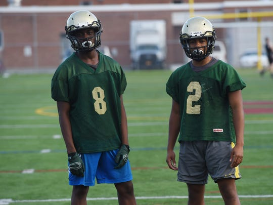 FDR's Justin Martin, left, and Elijah Hewitt, right, pictured during Thursday's practice at Arlington High School.