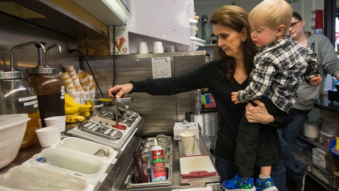 Owner and operator Pat Embke picks out ingredients while making a milkshake for her grandson Michael Bradford, 2, on Friday, April 6, 2018, at the Dairy Delite ice cream shop in Loveland, Colo.