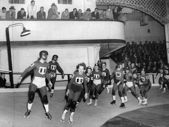 In this 1946 photo, skaters compete in a roller derby at the East Main Armory.
