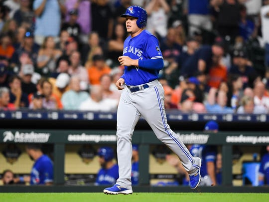 Jun 25, 2018; Houston, TX, USA; Toronto Blue Jays third baseman Gio Urshela (3) runs to home plate on a two-run home run hit by left fielder Randal Grichuk (not pictured) during the eighth inning against the Houston Astros at Minute Maid Park.