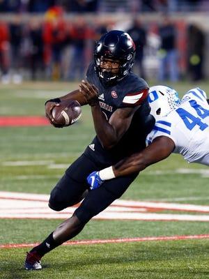 Louisville's Lamar Jackson scrambles free from Duke's Joe Giles-Harris.Oct. 14, 2016