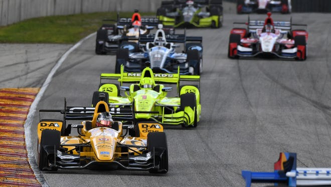 Graham Rahal rolls into Road America's Turn 5 with Simon Pagenaud behind him during the Kohler Grand Prix.