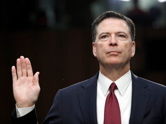 Former FBI director James Comey is sworn in during