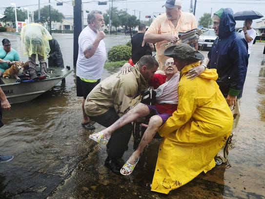 Neighbors use their personal boats to rescue Jane Rhodes