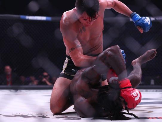 Emmanuel Sanchez (top) fights Daniel Straus during
