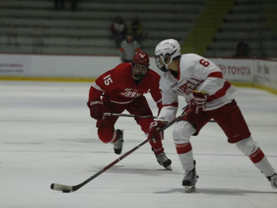 Forward Trevor Yates (red) races after Alex Green during