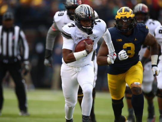 Ohio State's Dwayne Haskins runs the ball in the second