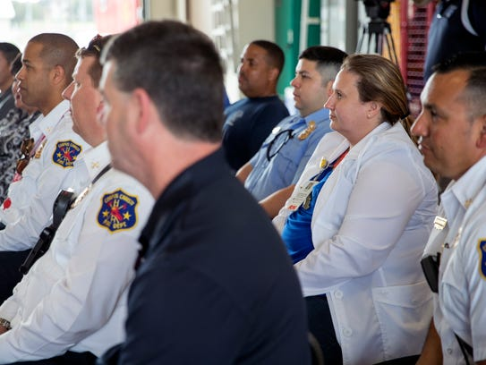 Firefighters and members of the public attend the kickoff