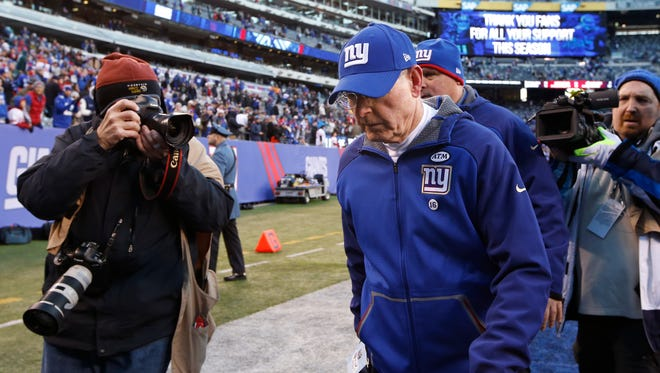 New York Giants head coach Tom Coughlin walks off the field after the Giants lost to the Philadelphia Eagles, 30-35, Sunday.