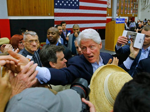 Former President Bill Clinton greets supporters as