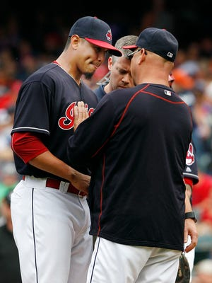 Carlos Carrasco of the Cleveland Indians talks with Manager Terry Francona after being hit by a line drive by Ian Kinsler of the Detroit Tigers in the first inning at Progressive Field on September 17, 2016 in Cleveland, Ohio.