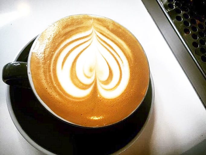 Creative coffee art by the baristas at Hub Coffee Roasters.