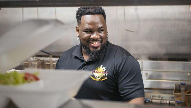 Jordan Marseille, owner of Alberte's Restaurant, in the kitchen of his suburban Lake Worth eatery weeks before the coronavirus crisis hit.