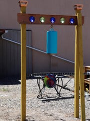 A hanging bell created by Bill Diers is one of the attractions at the new pocket park behind Studio 116 in downtown Farmington.