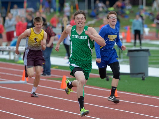Turner's Cody Welsh wins his heat of the 300-meter hurdles during the Ralph Halverson Northern C Divisional Track Meet at Memorial Stadium.