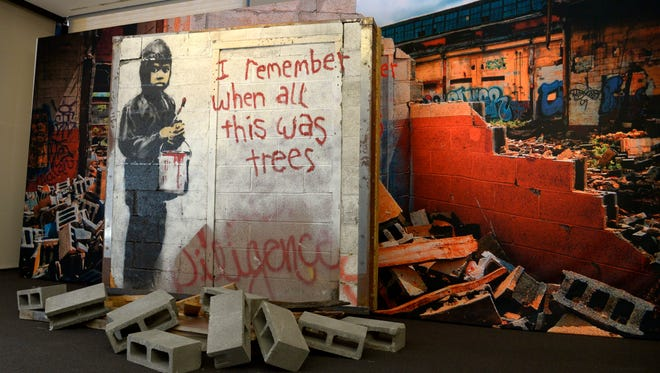 "A general view shows the ""I Remember When All This Was Trees"" mural by Banksy on display as part of the Street Art featuring Banksy at Julien's Auctions in Beverly Hills, Calif on Sept. 23, 2015."