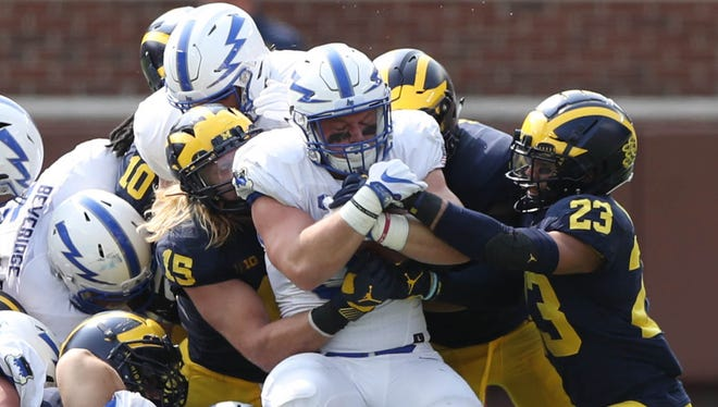 Michigan defenders stop Air Force's Parker Wilson in the second quarter Saturday, Sept. 16, 2017 at Michigan Stadium.