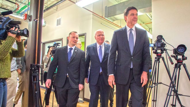 U.S. Sen. Patrick Leahy, center, and then-FBI Director James Comey, right, tour the Leahy Center for Digital Investigation with Champlain College professor Jonathan Rajewski on in April 2015.