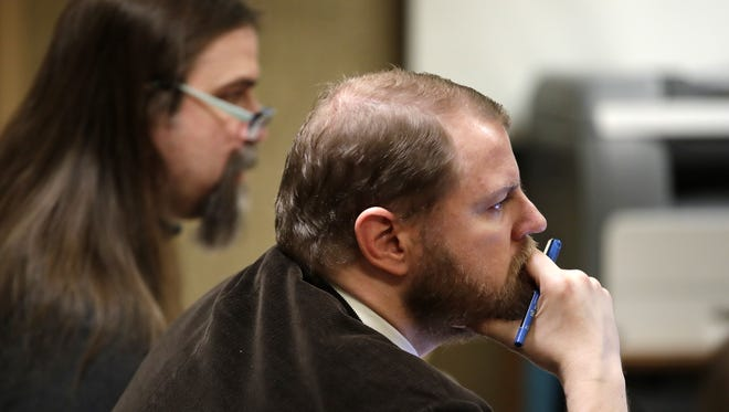 Public defender Ben Szilagyi, right, listens Friday during the fifth day of Brian T. Flatoff's trial in Winnebago County Circuit Court in Oshkosh. Flatoff, left, had been representing himself until he asked for an attorney on Thursday.