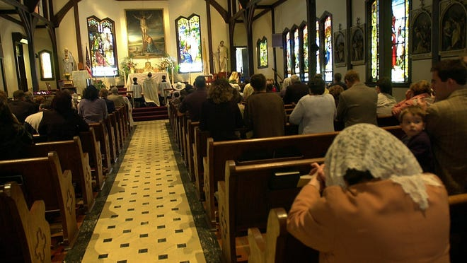 Worshippers pray at the Church of the Magdalene in Pocantico Hills.