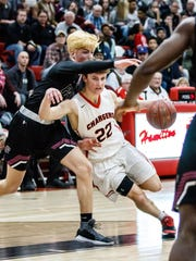 Sussex Hamilton sophomore J.T. Hoytink (22) breaks around Menomonee Falls senior Bo Siebert (5) during the game at Hamilton on Friday, Feb. 16, 2018.