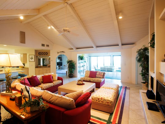The living room of a home rented by Select Vacation Properties in Sanibel.  It is one of the homes on West Gulf Drive that features a path to the Gulf of Mexico.