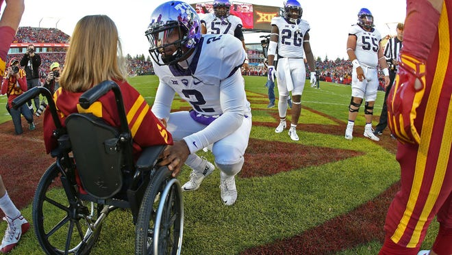 TCU quarterback Trevone Boykin speaks with Abby Faber, an Iowa State honorary captain, before the coin toss for a Big 12 Conference game in Ames this year.