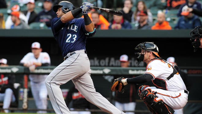 Seattle Mariners designated hitter Nelson Cruz (23) hits a two run single in the first inning against the Baltimore Orioles at Oriole Park at Camden Yards.