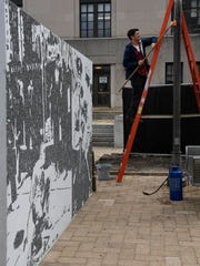 Duncan McDaniel of Art Up prepares the site of the