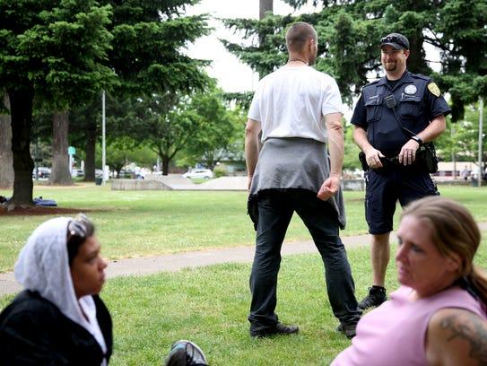 Salem Police Officer Andrew McFerron, talks with Jason