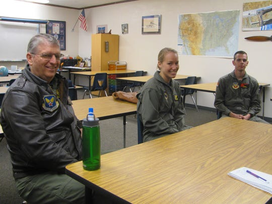 Retired Col. Glenn Whicker, left, the senior aerospace science instructor for Washington County's JROTC program, visits with cadets Andria Webb, center, and Justin Lewis in this December 2015 file photo.