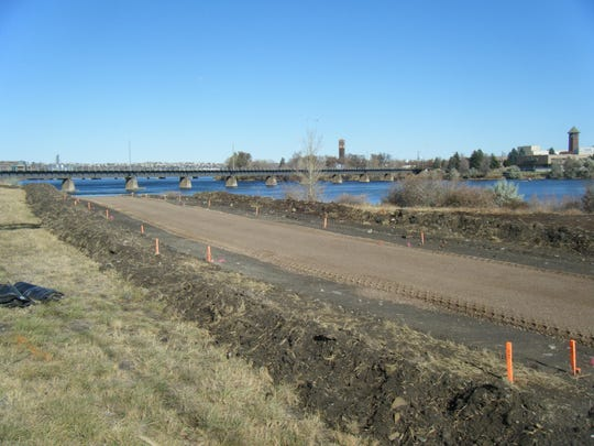 Work takes place on an extension of the River's Edge Trail on the West Bank of the Missouri south of the BNSF railroad bridge in 2009.