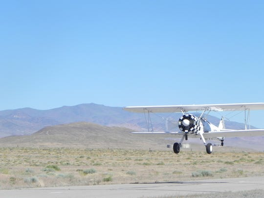 An Ageless Aviation 1940s Boeing Stearman airplane takes off from Tiger Field on June 22.