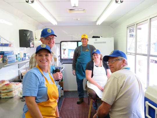 "Rothschild-Weston Lions Club finished their 2016 fundraising year with two days of frying up cheese curds, hamburgers and brats for hungry customers at downtown Wausau's ""Festival of Arts."" Profits from the sales of these products provide the ""Lions share"" of the budget needed to support more than 16 year-long community projects. Some local benefactors include the Salvation Army, Randlin Homes, The Neighbors Place, Leader Dog program, student scholarships, youth exchange programs and eye glasses for those in need. Pictured are Lions Amy Graham, from left, Tony Schillinger, Mark Rieck, Cheryl Rieck and Dennis Borchardt as they actively get ready for their shift."