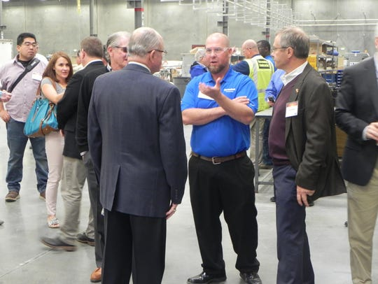 Dignitaries mingle at the newly opened Deceuninck plant