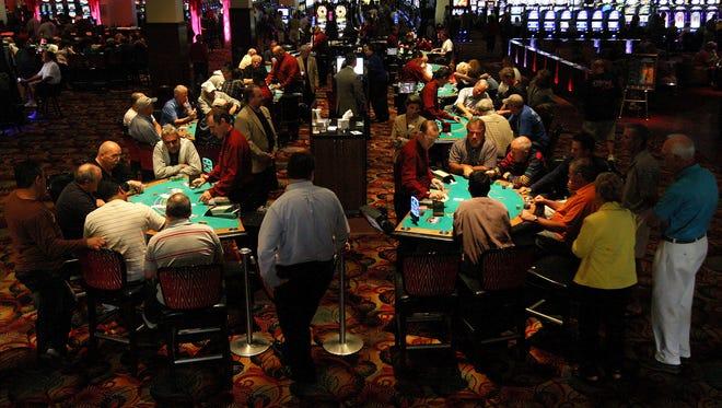 Seminole Casino Immokalee patrons play blackjack.