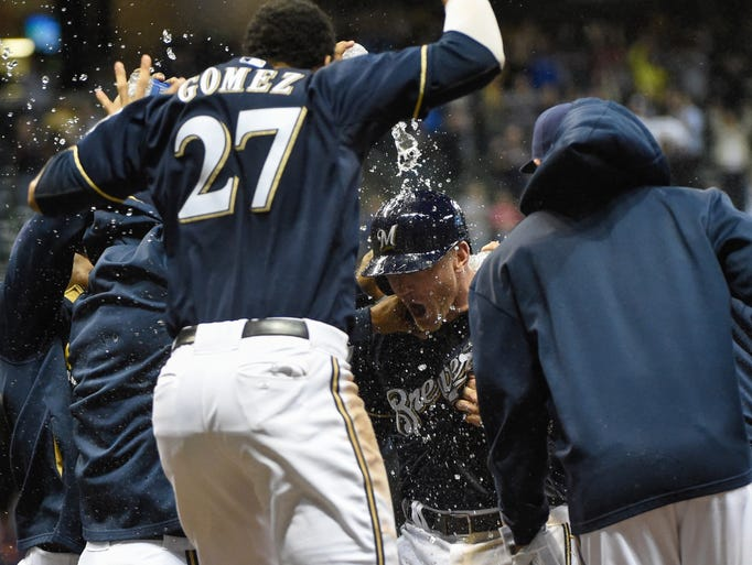Sept. 12: Milwaukee Brewers first baseman Lyle Overbay is doused with water by teammates after hitting the game winning run in the ninth inning against the Cincinnati Reds at Miller Park.