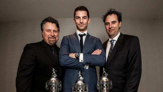 Michael Andretti (from left), Alexander Rossi and Bryan Herta pose with their Baby Borgs. Rossi won the 100th Indianapolis 500. Andretti and Herta were the team owners.  ©2017, Michael L. Levitt