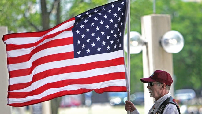 Thomas Sberna of West Allis, a member of the Patriot Guard Riders, held an American flag during the 2012 Flag Day Celebration at the Marcus Center's Peck Pavillion.