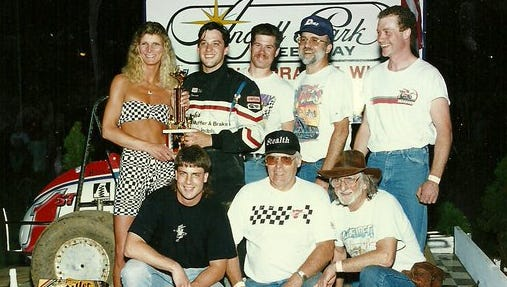 Tony Stewart celebrates his only Angell Park Speedway feature victory with car owner Jay McKinnie and crew after winning the Badger Midget Series-sanctioned event on May 22, 1994.