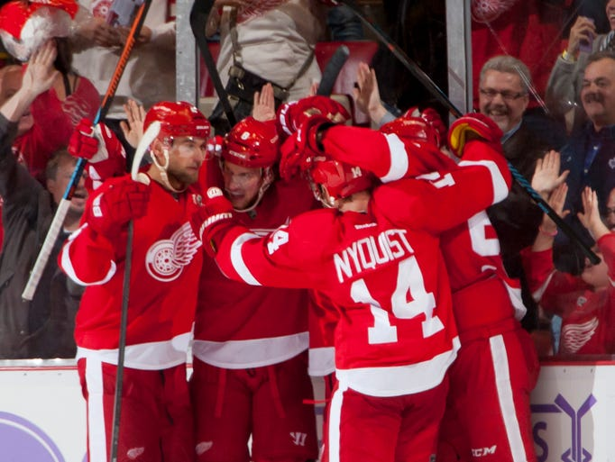 The Red Wings celebrate the winning goal by Justin