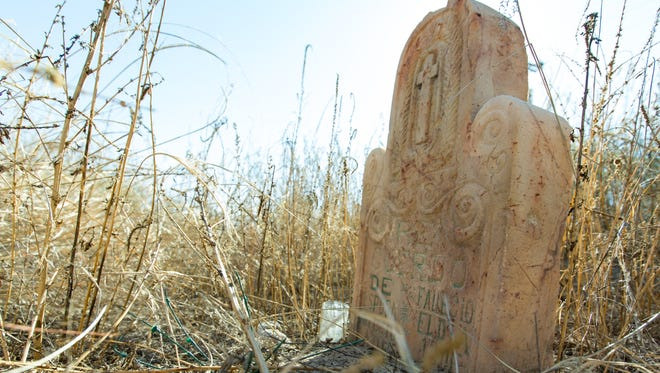 The Doña Ana County historical society purchased the El Campo Santo de la Familia Sagrada at a tax auction on Friday, Dec. 15, 2017. Two headstones and a number of other weathered grave sites remain on the dilapidated property.