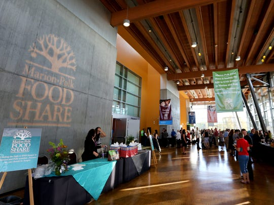 Diners mingle during Chefs' Nite Out at the Salem Convention Center, Sunday, Oct. 4, 2015, in Salem, Ore. The event is a fundraiser for the Marion-Polk Food Share.