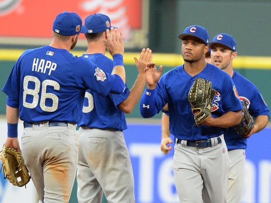 The Chicago Cubs celebrate a 6-3 win over the Houston Astros in an exhibition baseball game Friday, March 31, 2017, in Houston. (AP Photo/George Bridges)