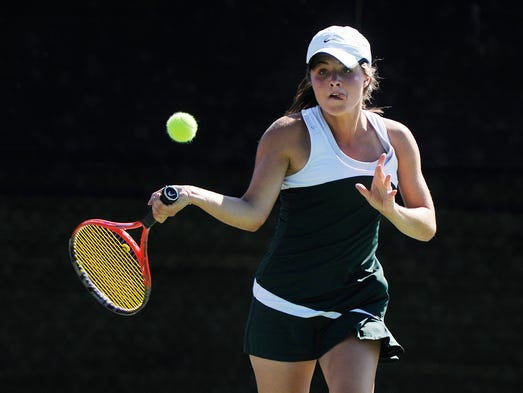 Wilson Memorial High School's Heather Shields returns the ball to her Gate City opponent during the 2A girls' tennis championship on Saturday, June 14, 2014 in Radford.