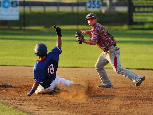 The Waynesboro Generals' Mike Marcinko turns a double plays as the Staunton Braves' Joey Rodriguez slides by him during their game in Waynesboro on Tuesday, July 1, 2014.