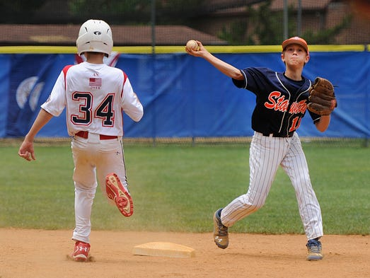 Staunton's Kaden Welcher tries unsuccessfully to turn a double play after getting a force out at second base during their game against Winter Park in the Cal Ripken 12-year-old Southeast Regional Tournament at Gypsy Hill Park on Thursday, July 17, 2014.
