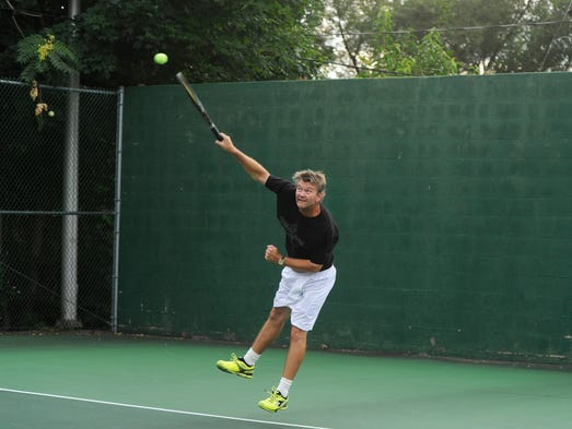 Chris Stambaugh serves the ball during an open men's singles match in the Augusta Health/News Leader Tennis Tournament at Mary Baldwin College on Tuesday, July 29, 2014.