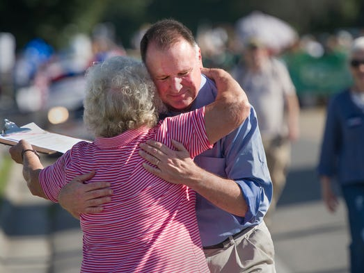 State Sen. Creigh Deeds, D-Millboro, hugs a supporter along the parade route of the Annual Buena Vista Labor Day Festival on Monday, Sept. 1, 2014.