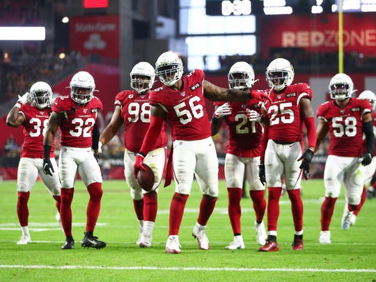 Dec 8, 2019; Glendale, AZ, USA; Arizona Cardinals linebacker Terrell Suggs (56) celebrates a fumble with teammates against the Pittsburgh Steelers in the first half at State Farm Stadium. Mandatory Credit: Mark J. Rebilas-USA TODAY Sports